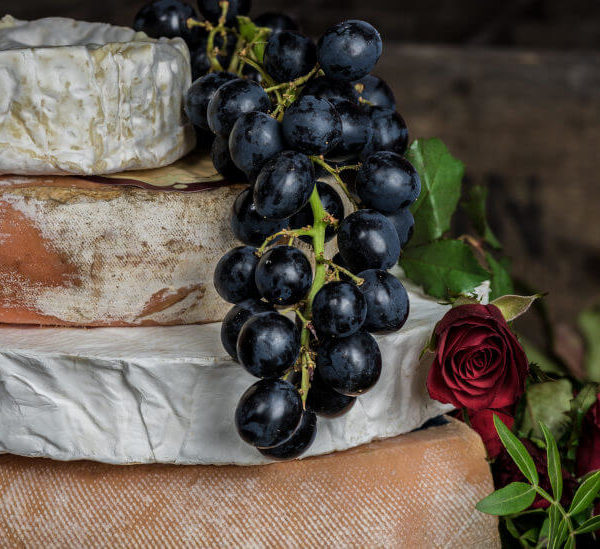Cheeses, grapes and red roses