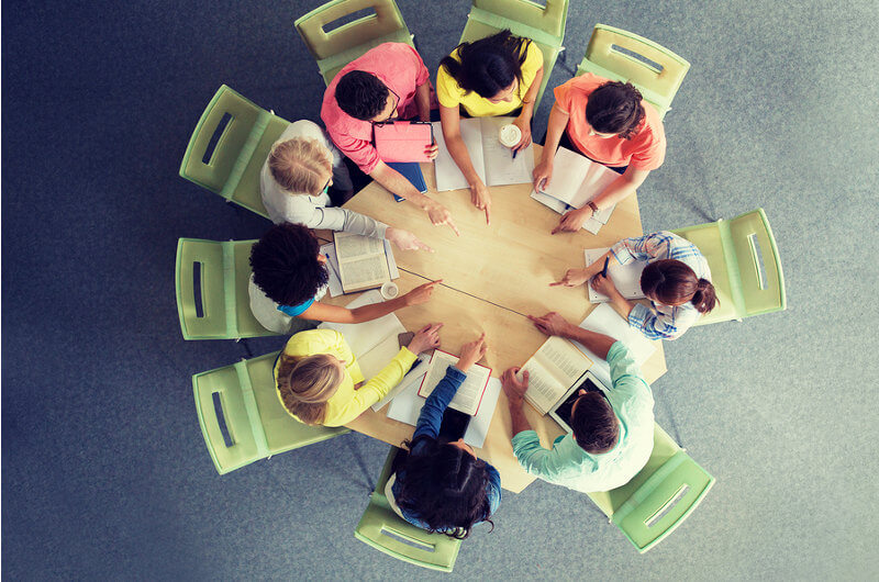 Students sitting down at a table