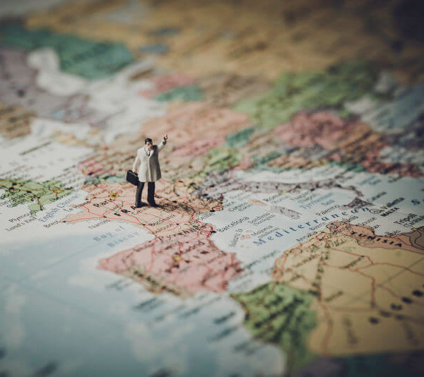 Doll standing upon France in a map