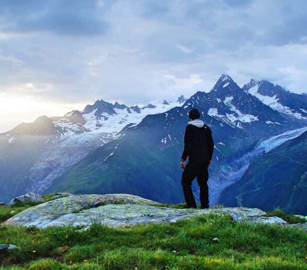 Man looking at a mountain