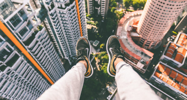 Feet dangling over edge of a building